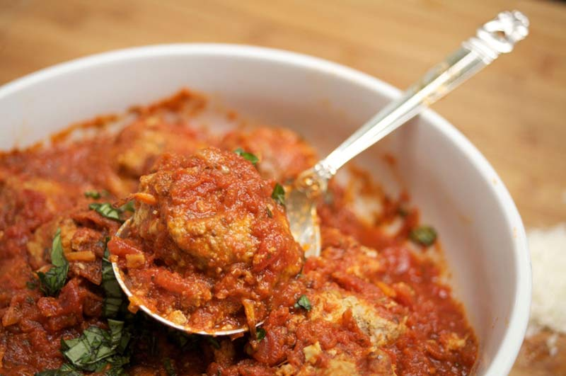 These mouth-watering Mediterranean meatballs, bathed in  double tomato herb sauce, manage to be sumptuous -- airy and fluffy -- yet surprisingly light on calories