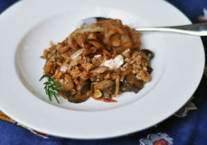 ... baked rice dish with sweet caramelized onions is full of dark mushroom