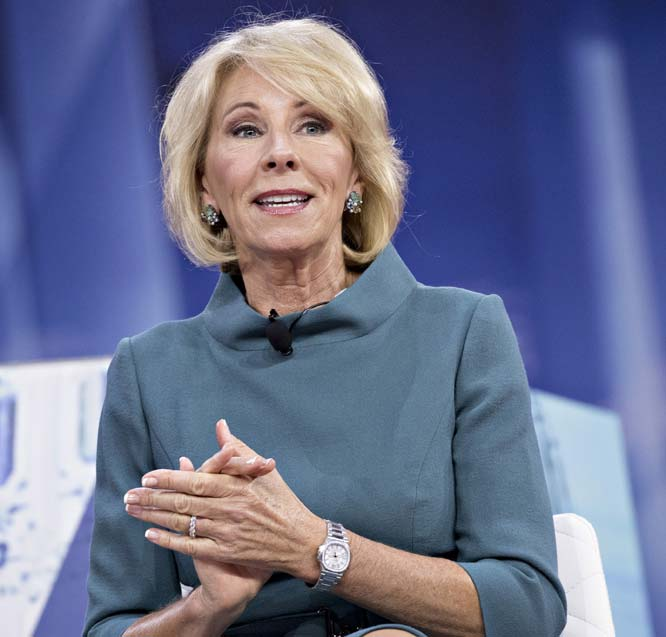 Betsy DeVos is trying to stop an assault on civil rights on college campuses. Guess who is trying to stop her