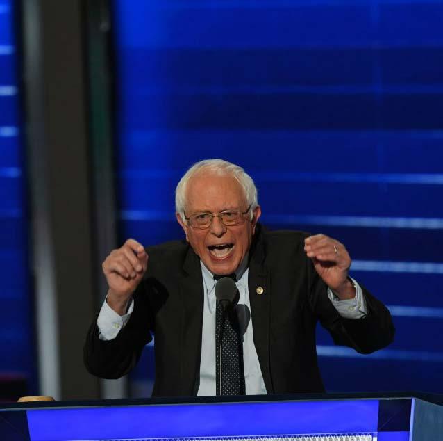 Under attack, Sanders defends democratic socialism; reflecting internal Dem battle over party philosophy